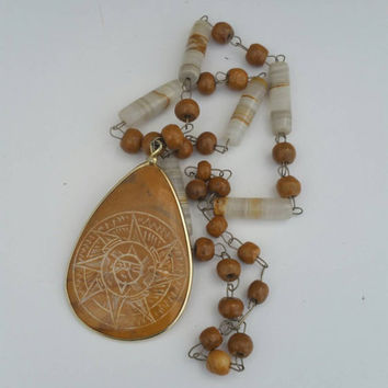 Etched rock pendant lariat with wood and stone beads