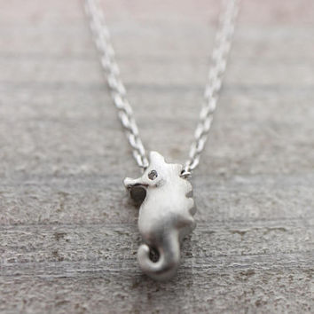 Tiny cubic eye seahorse silver necklace