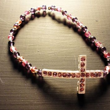 Bracelet purple hues crystal beads and side ways cross