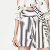 PLEATED BERMUDA SHORTS WITH BOW
