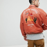 ASOS Oversized Varsity Jacket With Embroidery In Red at asos.com