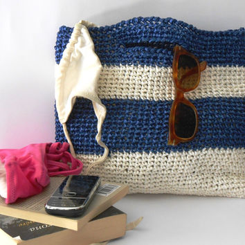 Crochet clutchbag vintage style  of cellulose raffia, blue and ivory white, nautical stripes