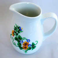 White Ceramic Pitcher With Painted Flowers
