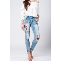 Washed jeans with butterfly and roses embroidery