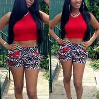 Red Sleeveless Cropped Top and Animal Print Shorts