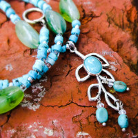 Colorful turquoise drop leaf pendent necklace.
