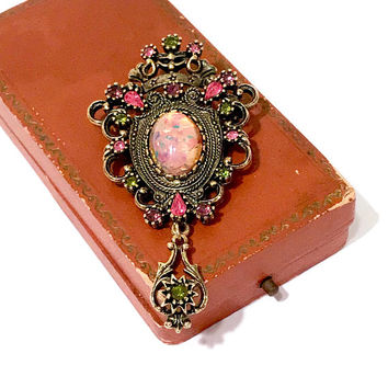 Sarah Coventry Contessa Brooch, Dangle Pendant, Faux Fire Opal Center, Pink Purple Green Rhinestones, Ornate, Antique Gold Tone, Collectible