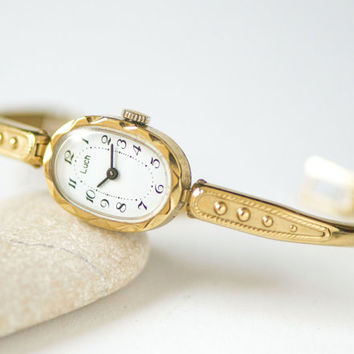 Oval watch bracelet ornamented, gold plated ladies wristwatch Ray, cocktail wrist watch small, mechanical watch her, party watch woman gift