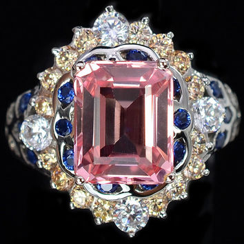 A Vintage 4.55CT Emerald cut Pink Sapphire & Blue, White and Pale Beige Accented Ring
