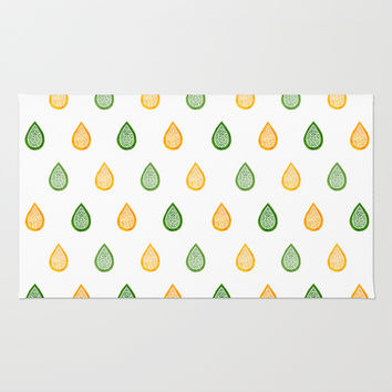 Yellow and green raindrops Rug by Savousepate