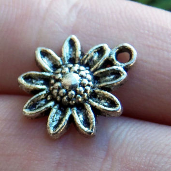 8 Cute daisy or sunflower charms in silver tone ~ F232