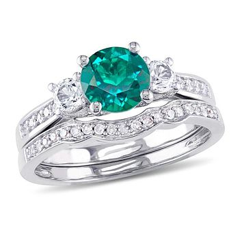 6.0mm Lab-Created Emerald and White Sapphire with 1/8 CT. T.W. Diamond Three Stone Bridal Engagement Ring Set in 14K White Gold