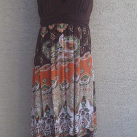 Maxi dress from Candies size large brown orange and green design mod hippie sexy boho look polyester and spandex blend ties in back