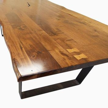 Live edge Walnut dining table with Flat iron legs