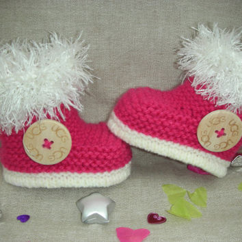 Beautifully hand knitted baby girl *H UGG Y* booties/slippers in raspberry yarn with large wooden designer button.