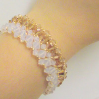 Opal  Gold  Bracelet Swarovski  , Miyuki Seed Beads ,Handmade ,Woven,Beadweaving, with a Gold Plated Lobster Clasp.