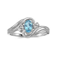 14kt White Gold 7/5mm Oval Blue Topaz and Diamond Ring