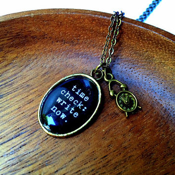 Time Check: Write Now. Necklace, resin cabochon pendant with alarm clock charm