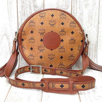Vintage MCM rare brown monogram round shape shoulder bag with brown leather trimmings. Great masterpiece for unisex use.