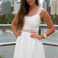 White Sleeveless Dress with Embroidered Waist