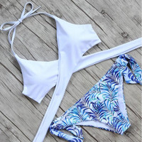 Upper white cross halter bottom blue print print two piece bikini swimsuit
