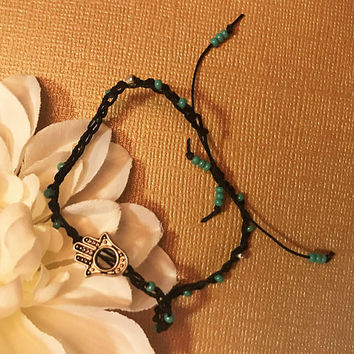 Hamsa Crochet bead anklet with silver and turquoise beads and a silver hamsa charm adjustable slip knot