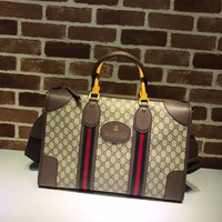 Gucci Soft GG Supreme duffle bag with Web