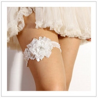 Lace blossom garter  pale ivory floral lace bridal garter by woomi