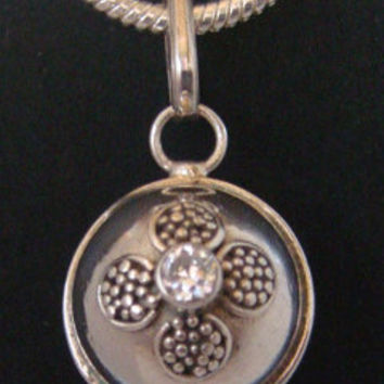 Sterling Silver Harmony Ball with 2 CZ Stones in a Flower Setting, one on each side of a 925 Sterling Silver Highly Polished Ball - 249