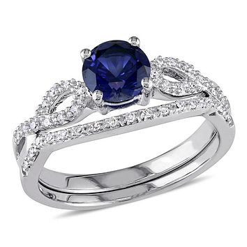 6.0mm Lab-Created Blue Sapphire and 1/8 CT. T.W. Diamond Twist Shank Bridal Engagement Ring Set in 14K White Gold