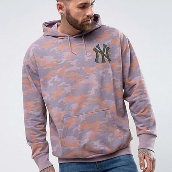 Majestic Oversized Yankees Hoodie In Camo Exclusive to ASOS at asos.com