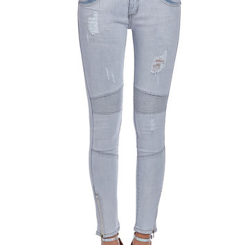 Gray skinny jeans with ankle zips