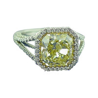 A Fancy Yellow Diamond and Platinum Ring