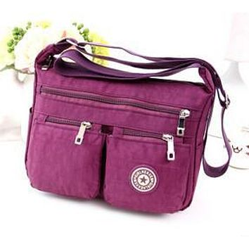 The new European and American fashion Shoulder Messenger canvas bag lightweight waterproof nylon oxford cloth travel bag