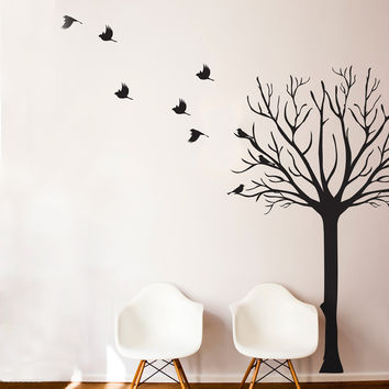 Leafless Tree Silhouette with Flock of Birds