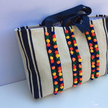 Carpet bag with blue and off white stripes, decorated with tiny colorful pompoms , woven, handmade bag, farmers market bag,beach bag