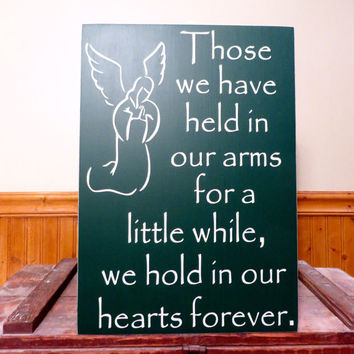Those we have held in our arms for a little while wood sign