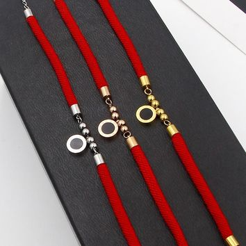 Hot lucky red string string ball Roman number black and white shell rope bracelet men and women stainless steel rope bracelet