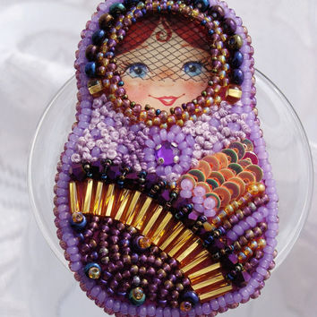 Matrioshka. Russian doll. Beaded Brooch handmade matryoshka. Russian doll ethnic female mascot.