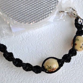 Reflector in a black macrame cord with ceramic beads Cat's eye Pedestrians' safety Be safe with style