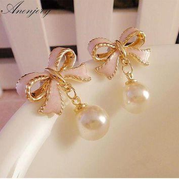 Anenjery High Quality Delicate Gold Color Pink Drops Of Oil Butterfly Bow Knot Pearl Stud Earrings For Women Brincos E22