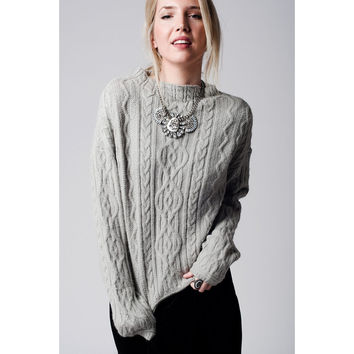Grey cable knit sweater with ribbed collar