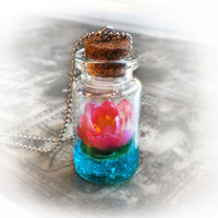 Lotus flower on a magic lake bottle necklace vial by UraniaArt