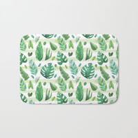 Tropical palm tree leaves background Bath Mat by Smyrna