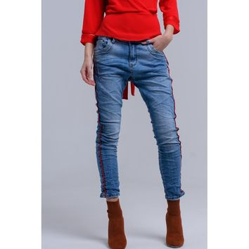 Boyfriend jeans with red bands.
