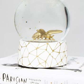 Paperchase Gothic Garden Gold Bee Snow Globe at asos.com