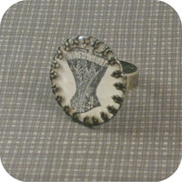 Aged brass bezel and resin vintage corset advertising image adjustable ring