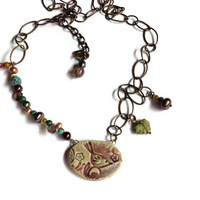 Hatchling with flowers Ceramic, pearl, smoky quartz, Czech glass and brass necklace