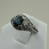 "Stunning ""Frozen"" Diamonds Surrounding A 1.64 Carat Midnight Blue Sapphire Set In A 10k White Gold Ring"