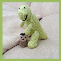 Knitted dinosaur toy and cave man